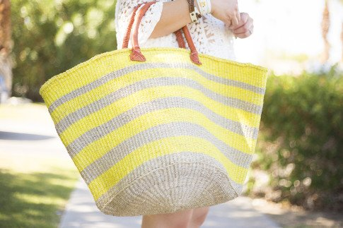An Dyer wearing Sole Society Keeva Yellow Striped Large Woven straw tote with stitched leather handle