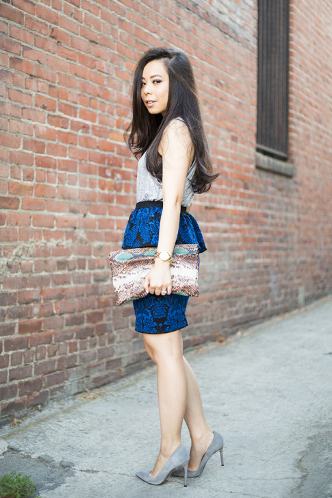 An Dyer wearing ShoeMint Bess Grey Suede Pump, Torn by Ronny Kobo Sasha Skirt in New Baroque, Zara Snake Print Clutch