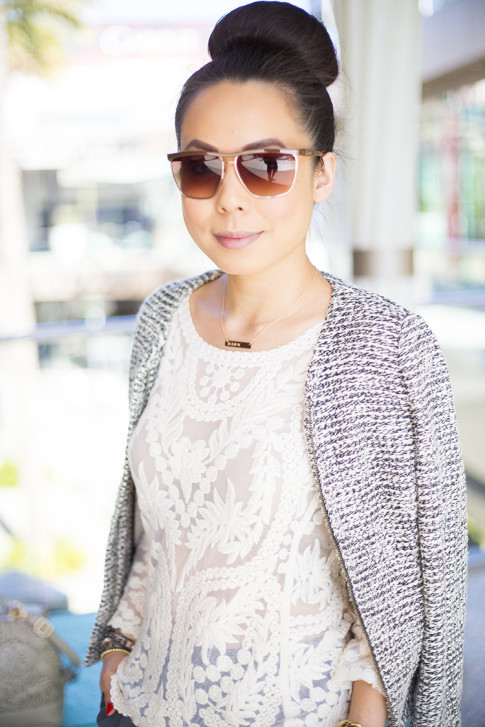 An Dyer wearing LOFT Peplum Tweed Jacket, BCBGMaxazria Square Aviators DBALovingThis, hair in high bun