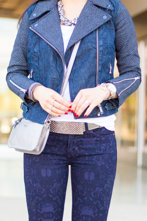 An Dyer wearing Levi's Combined Moto Jacket Chevron Denim, Revel Demi Skinny Purple Print, Cole Haan Village Crossbody Silver, Silver handcuff bracelet, Swarovski Slake Bracelet, Silver Bar two finger ring