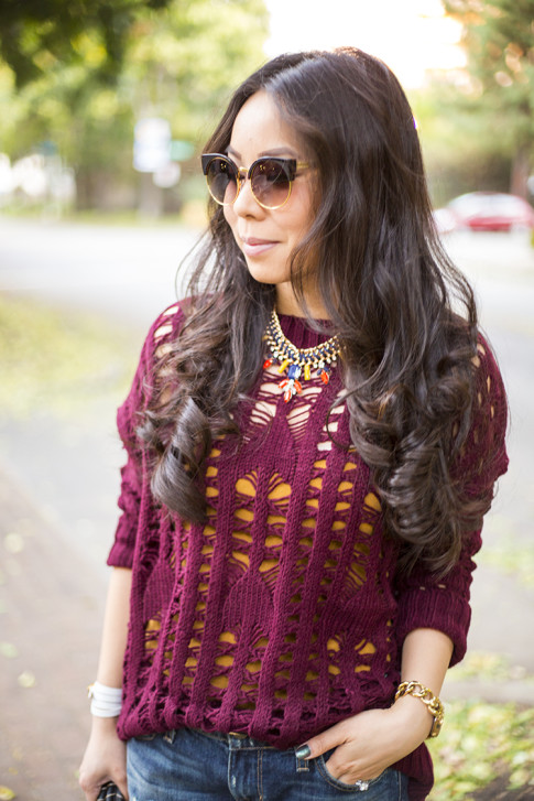 An Dyer wearing heartLoom Samara Knitted Sweater in Burgundy, Lily Wang Cat Eye Sunglasses