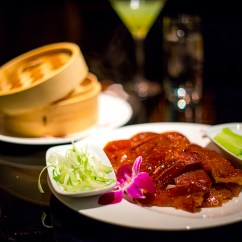 Lacquered Skin Peking Duck Carved and Served with Hand-made Porbien Crepe, Plum Sauce, and Julienne Cucumbers and Scallions