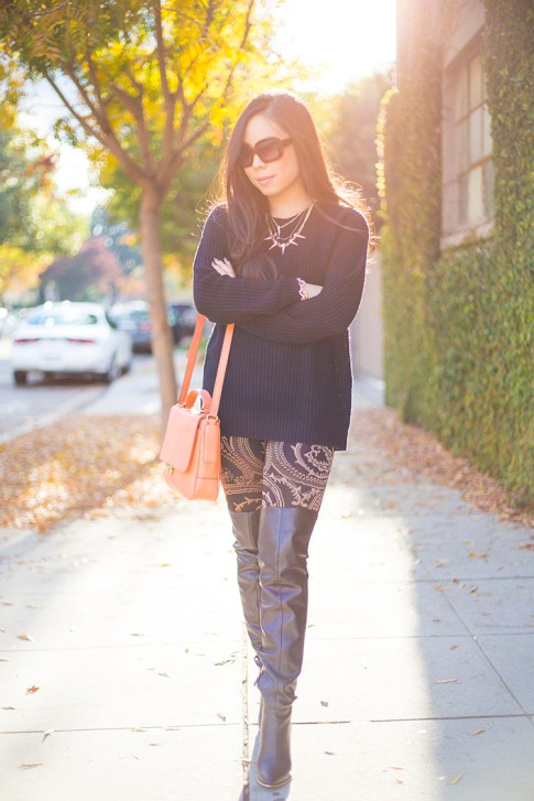 An Dyer wearing Twenty Tees Baroque Knit Jersey Leggings, Guess Zonia Boots, Fossil Memoir Novel Flap, Rose Gold accents