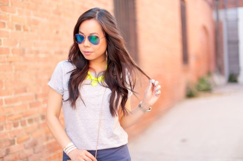 An Dyer wearing Foster Grant Blue Mirrored Aviator Sunglasses, Neon Yellow Necklace and The One by Cotton On Tee, Hermes Hapi 3mm