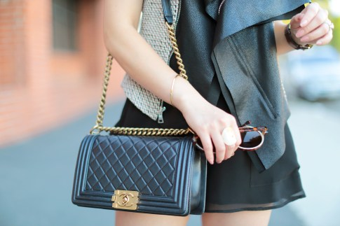 An Dyer wearing Chanel Pearly Black Lambskin GHW Old Medium Boy Bag, Dogeared Balance Bracelet, Foster Grant