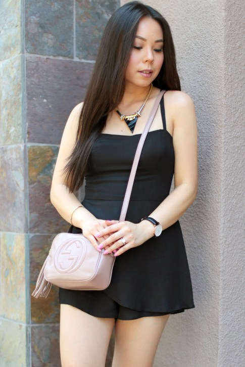 An Dyer wearing Della Urban Outfitters Black Romper, Gucci Soho Disco Bag