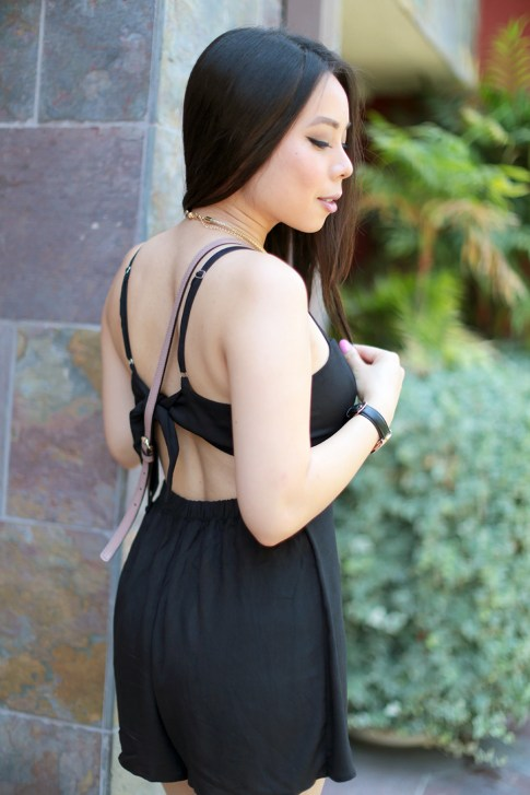An Dyer wearing Della Urban Outfitters Black Romper back 2