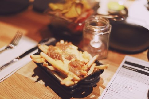Beast Fries - schmaltz onions, bacon spread, Americanized cheese... also exclusive!