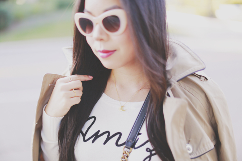 An Dyer wearing Triple Graces Sunglasses, Love you to the moon necklace, Express Trench