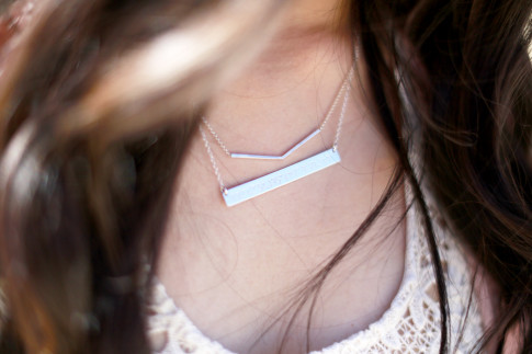 An Dyer wearing Dogeared Balance Necklace with Coordinates Necklace