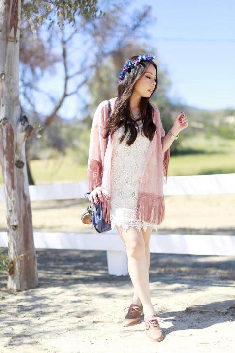 An Dyer wearing Pink Fringe Kimono Crochet Dress Purple Blue Flower Crown Coachella Street Style Festival outfit