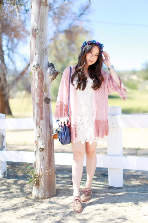 An Dyer wearing Pink Fringe Kimono Crochet Dress Purple Blue Flower Crown Coachella Street Style Festival