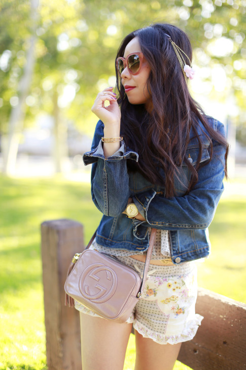 An Dyer wearing Blush Pink Celine Audrey Sunglasses with Karen Kane Leather Jacket, Hair Flower Chain, Gucci Soho Disco