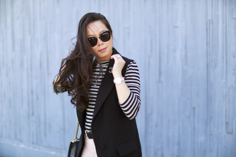 An Dyer wearing CLUSE pink leather Watch and Haus of Moo Sunglasses
