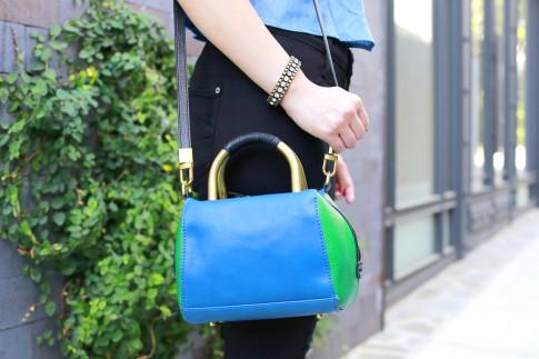 An Dyer wearing Hare Hart Blue Green Crossbody with Loren Hope Bracelet