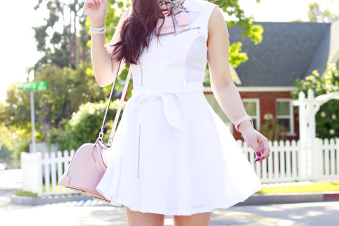 An Dyer wearing Marciano White Moto Dress