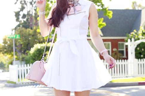 An Dyer wearing Marciano White Moto Dress