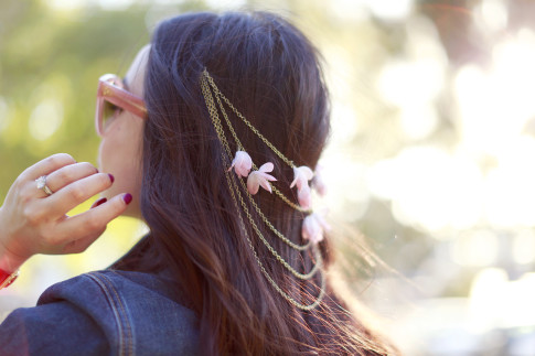 An Dyer wearing Pink Flower Hair Chain