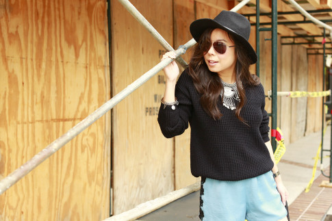 An Dyer wearing Fisherman Sweater with Satin Shorts and Dylanlex inspired Necklace with Fedora