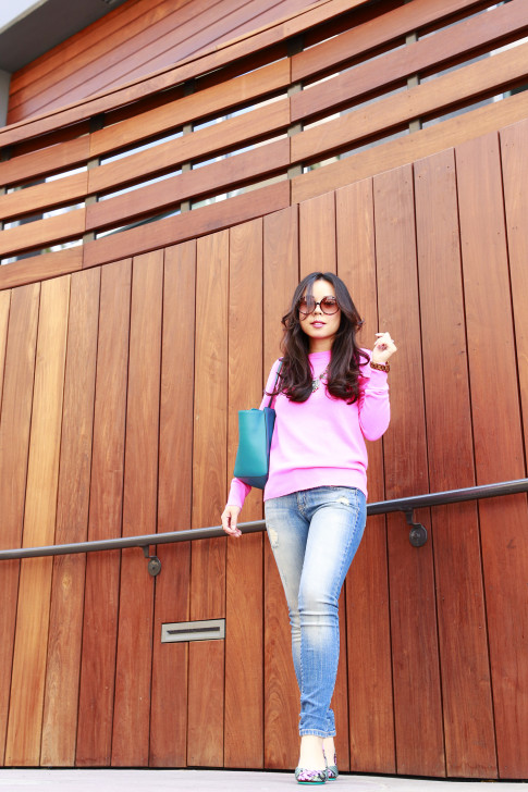 An Dyer wearing Foster Grant, White Warren Hot Pink Cashmere Sweater with Hart Denim jeans