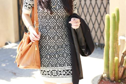 An Dyer wearing Karen Kane dress with Ora Delphine Bucket Bag