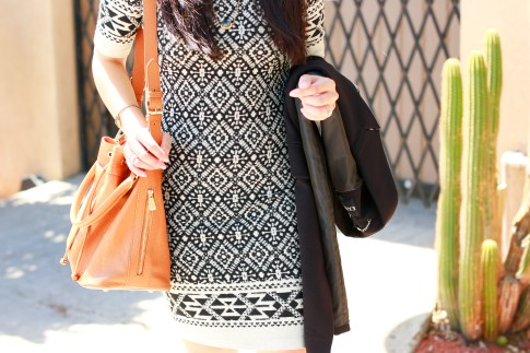 An Dyer wearing Karen Kane dress with Ora Delphine Bucket Bag