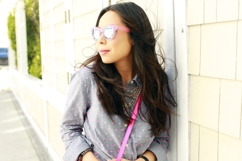 An Dyer wearing TOMS Travelers Sunglasses, Juliet and Co Layered Gold Necklace