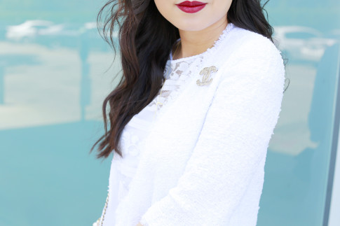 An Dyer wearing Chanel Brooch on White Tween Jacket