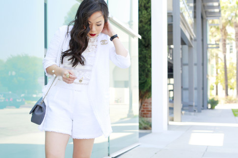 An Dyer wearing Eve by Eve's White Tweed Short Set with Chanel Brooch and bag