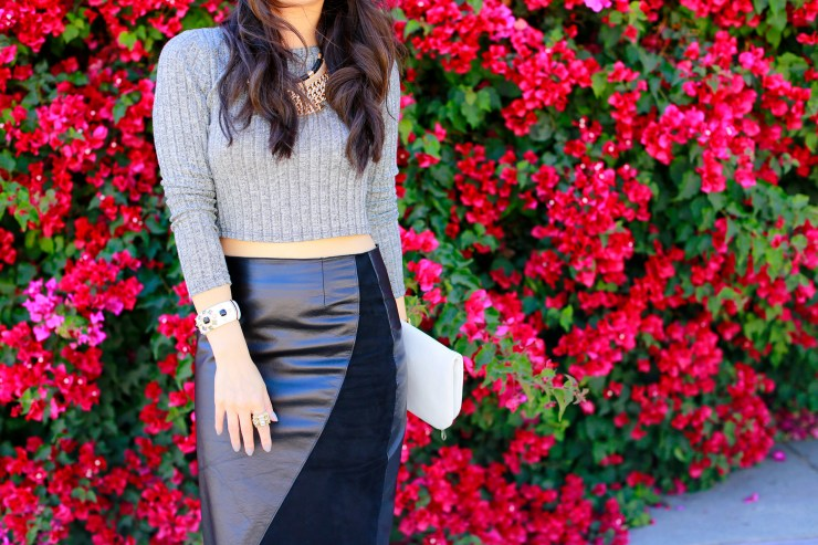 An Dyer wearing Khalo BLACK LEATHER BLACK SUEDE ANGULAR SPLIT SKIRT with Crop Top