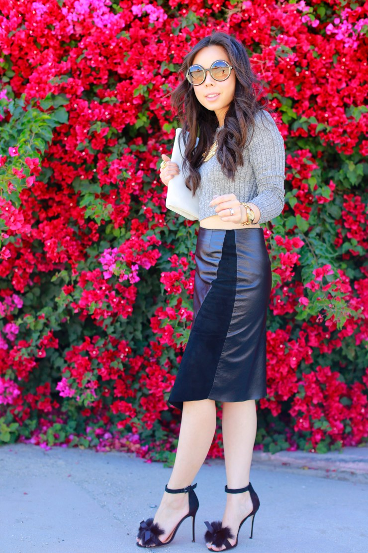 An Dyer wearing Khalo BLACK LEATHER BLACK SUEDE ANGULAR SPLIT SKIRT with fur bow sandals toe
