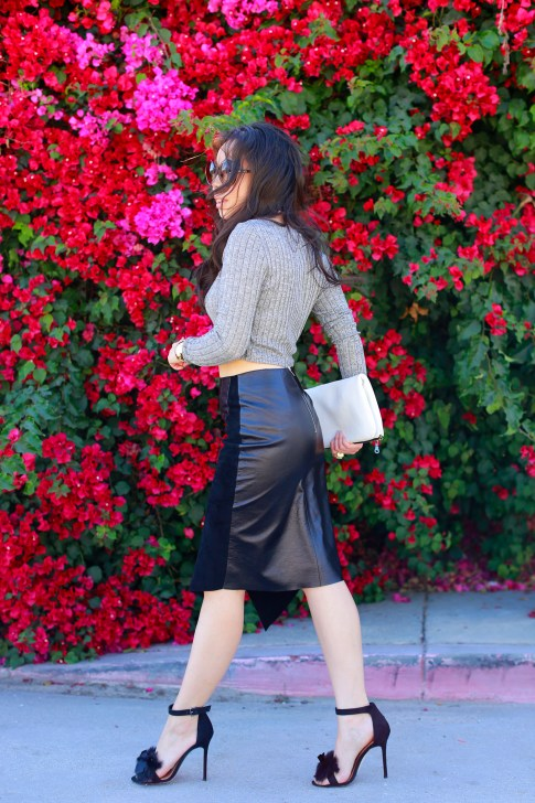 An Dyer wearing Khalo BLACK LEATHER BLACK SUEDE ANGULAR SPLIT SKIRT