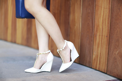 An Dyer wearing Qupid Shoes White Cream Wedge with Gold Hardware