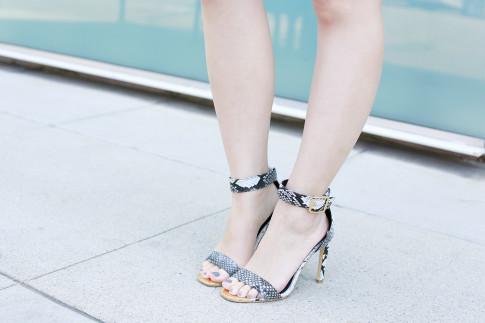 An Dyer wearing ShoeDazzle Snakeprint Sandals Gold Toe