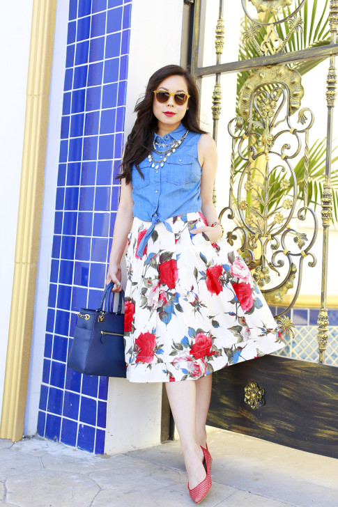 An Dyer wearing Triple Graces Yellow Sunglasses with Denim Tie Knot Shirt with Modclotch Floral Midi Skirt