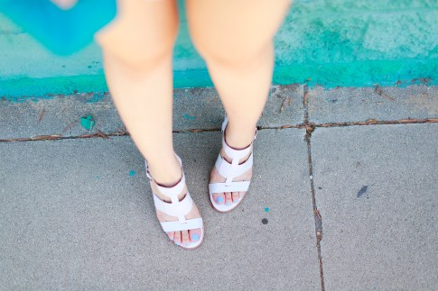 An Dyer wearing Arricci Harmony White Sandals, Essie Polish