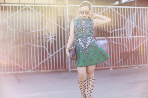 An Dyer wearing Chanel Clutch ChicWish Dress, ShoeDazzle Gladiator Wedge Lace Up Sandals