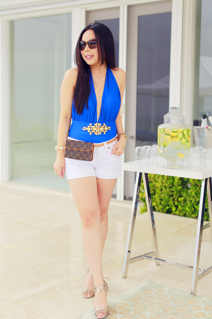 An Dyer blogger wearing Louis Vuitton Fanny Pack Forever Unique Cobalt Blue Bikini, Louis Vuitton Pouchette Florentine, True Religion Shorts, Klub Nico Wedges