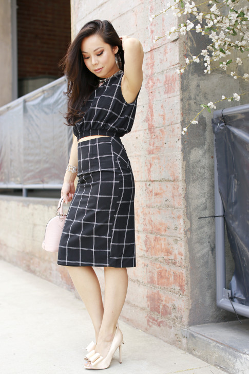 An Dyer wearing Line & Dot Black Windowpane Crop Top Midi Skirt, Nude Bow Pumps
