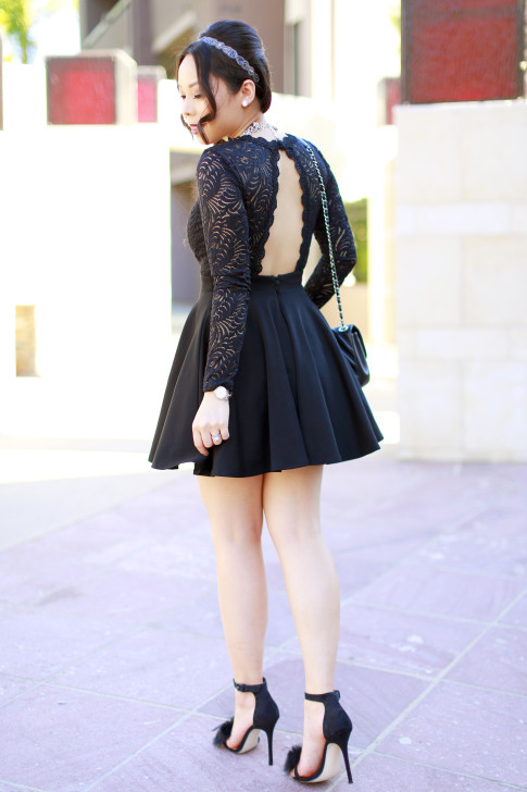 An Dyer wearing Bebe Black Lace Skater Dress open back