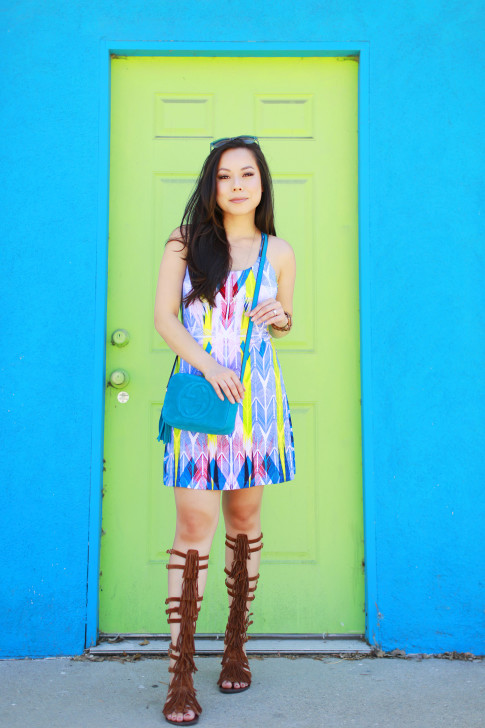 An Dyer wearing Gucci Soho Disco Teal Suede, Tart Collections Harper Dress with Steve Madden VILLANO Fringe Gladiator Sandals