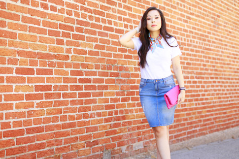 An Dyer wearing Hermes Twilly Neck Tie, Chanel Pink Foldover Quilted Clutch, Denim Pencil Skirt
