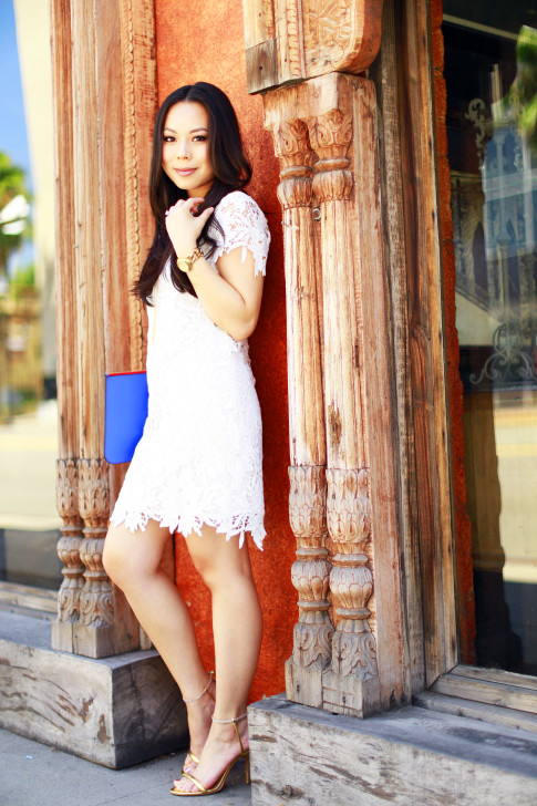 An Dyer wearing White Lace Crochet Shift Dress and gold encrusted sandals