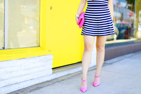 An Dyer wearing Hot Pink Bow T Strap Pumps