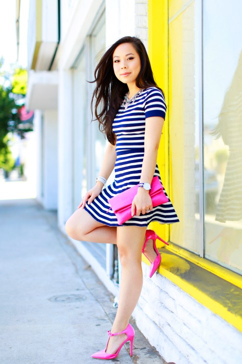 An Dyer wearing Lucy Paris Navy Striped Skirt Set with Hot Pink Chanel Clutch