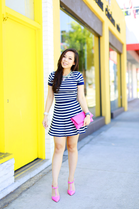 An Dyer wearing Lucy Paris Navy Striped Skirt Set with Hot Pink pumps & Chanel Clutch