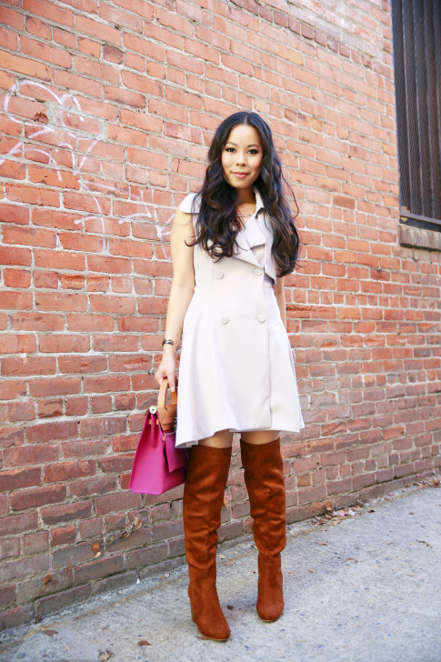 An Dyer wearing Chicwish Belted Sleeveless Trench Dress with JustFab Brown Over The Knee Boots