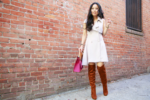 An Dyer wearing Chicwish Belted Sleeveless Trench Dress with OTK Boots