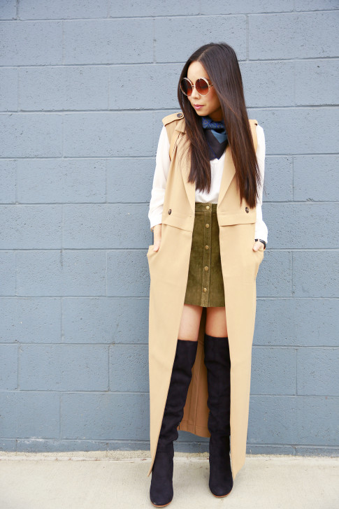 An Dyer wearing Hermes Gavroche Around Neck, Olive Suede Button Front Skirt Sleeveless Trench Duster, suede Over The Knee Boots