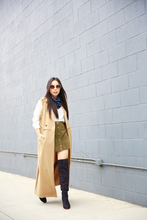 An Dyer wearing Hermes Scarf Around Neck, Olive Suede Button Front Skirt Sleeveless Trench Duster, JustFab suede Over The Knee Boots